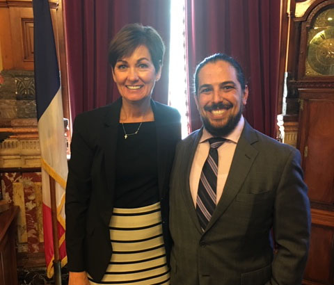 Chris Disbro of Iowa Hemp Association with Governor Kim Reynolds at the signing of the Iowa hemp bill